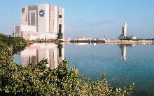 Kennedy Space Center rises above the water